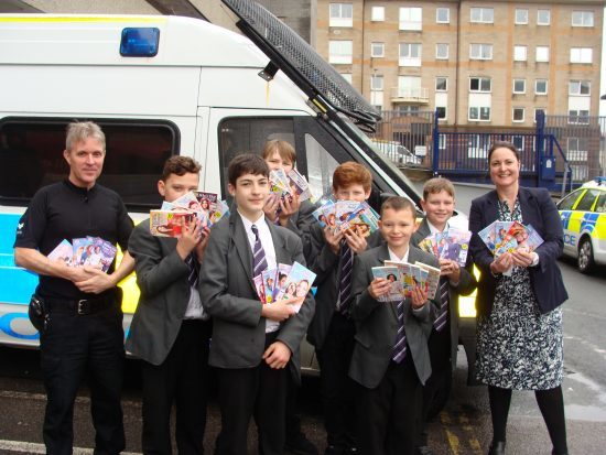 Police Sergeant John Livingstone, Plympton Academy pupils Brooklyn Hunter, Luke Vincent, Hayden Huckerby, Travis Scott, Bobby Hunter, Lewis Buller and Alison Hernandez, Police and Crime Commissioner for Devon and Cornwall,  with arms full of People's Friend Pocket Novels.