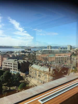 Views over Dundee city centre, towards Tay Rail Bridge. Vista room.