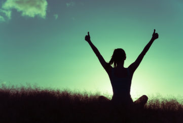 Woman celebrating and showing thumbs up. facing a challenging day