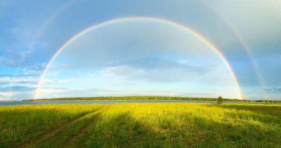 Double Rainbow over pond.