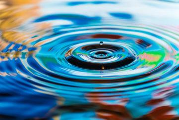 multicolored water drops stone ripples