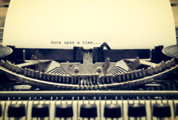 "Words ""Once upon a Time"" written with old typewriter on white paper in vintage style. story starters"