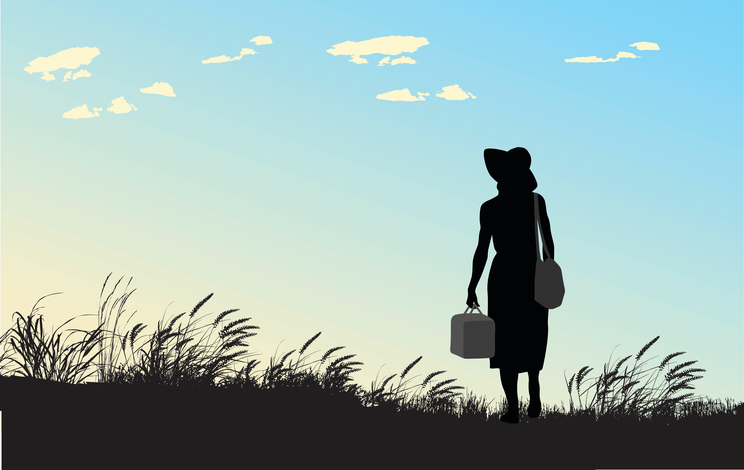A vector silhouette illustration of a woman standing alone in a grassy field carrying a purse and a luggage case wearing a sun hat infront of a blue sky with white clouds. Challenge yourself.