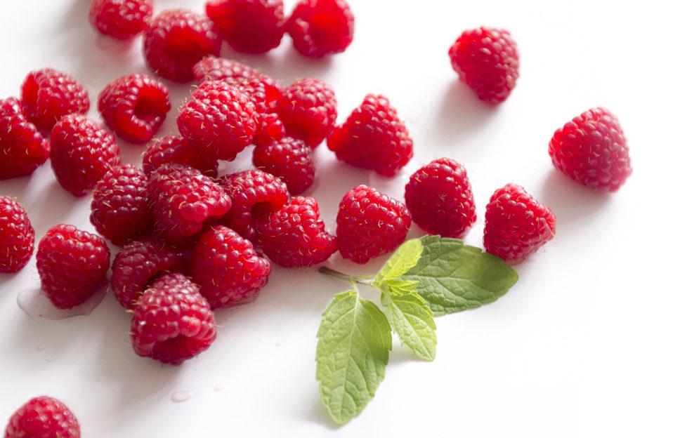 Fresh raspberries, white background. Prune
